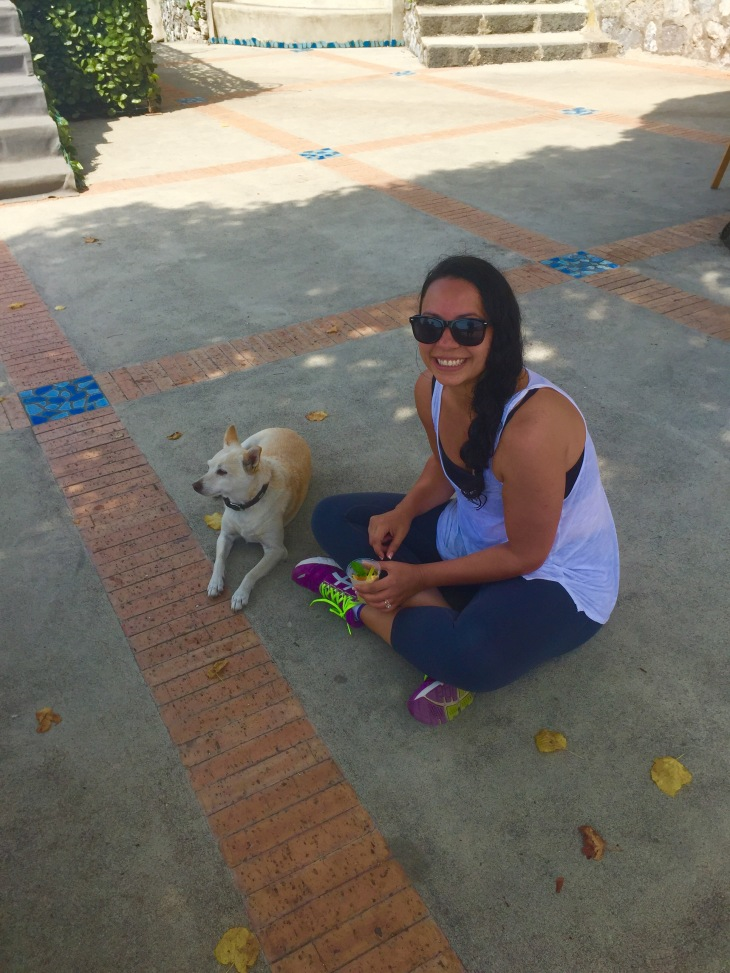 Sigalle Barness befriends dog in Nocelle Italy